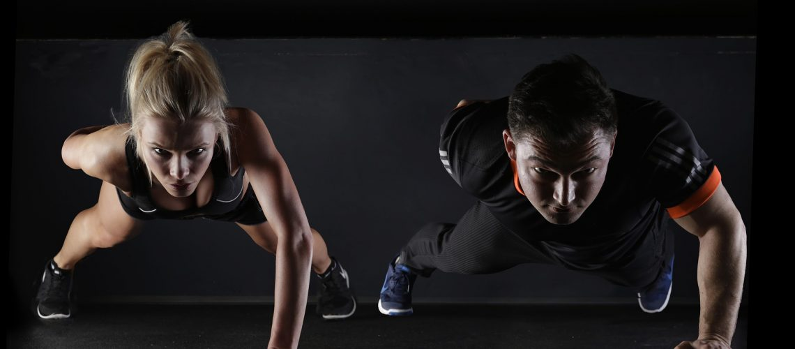 Man and woman exercising to keep fit